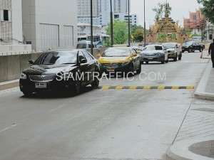 Installation of plastic speed bump at Siriraj hospital